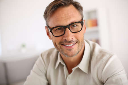 wearing glasses: Portrait of handsome guy with eyeglasses
