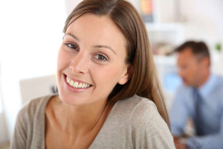 30 years old woman: Smiling young woman in office