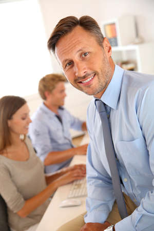 Business manager with employees in background Stock Photo - 22085865