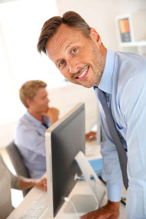 Business manager with employees in background photo