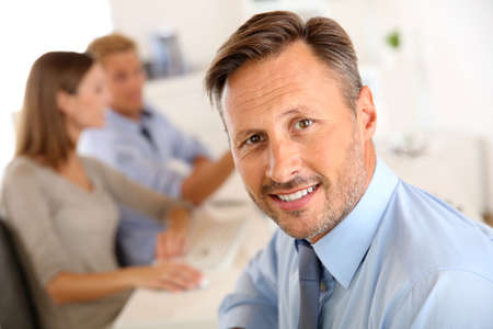 Business manager with employees in background Stock Photo - 22085869
