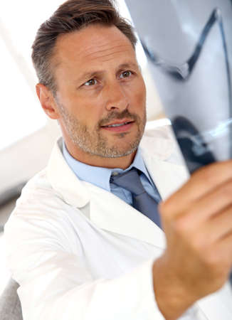 medicalcare: Doctor checking on X-Ray images
