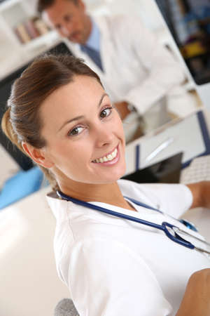 medicalcare: Beautiful nurse working in hospital office Stock Photo