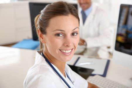 Beautiful nurse working in hospital office Stock Photo - 22085882