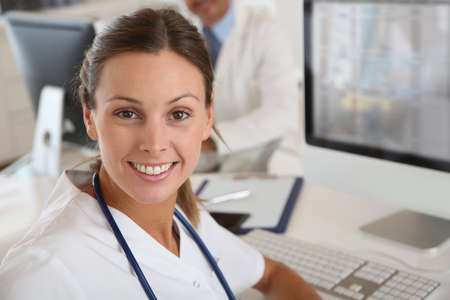 Beautiful nurse working in hospital office Stock Photo - 22085883