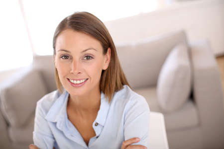 Beautiful woman working from home on laptop Stock Photo - 22099649