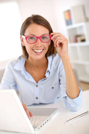 Businesswoman with eyeglasses working on laptop Stock Photo - 22099652