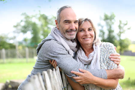 Cheerful senior couple enjoying peaceful nature photo