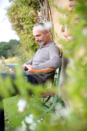 websurfing: Man relaxing in country house on week-end Stock Photo
