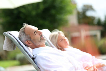 Senior couple in spa hotel relaxing in long chairs Stok Fotoğraf - 22398047