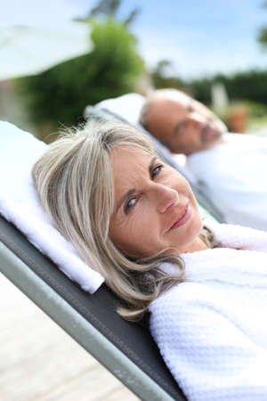 thalasso: Senior woman in spa hotel relaxing by the pool Stock Photo