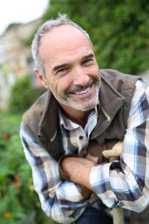 Portrait of senior gardener in vegetable garden Stock Photo - 22394801