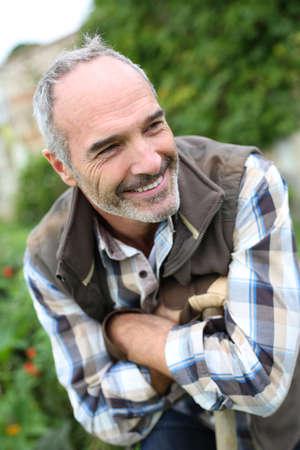 Portrait of senior gardener in vegetable garden Stock Photo - 22394802