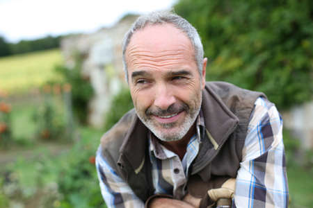 Portrait of senior gardener in vegetable garden Stock Photo - 22394803