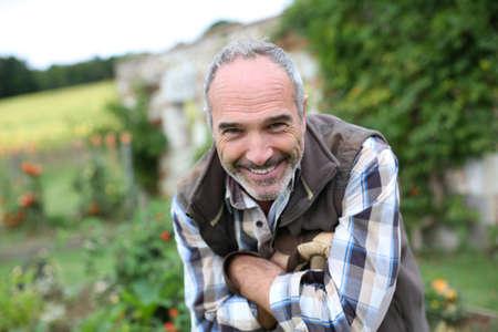 Portrait of senior gardener in vegetable garden Stock Photo - 22394804