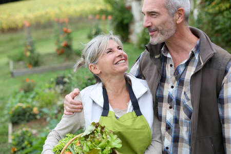 happy senior couple: Husband and wife enjoying being in kitchen garden