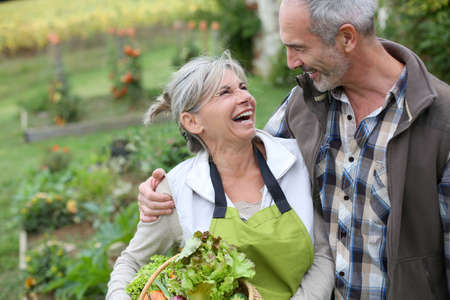 Husband and wife enjoying being in kitchen garden photo