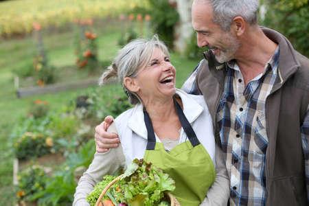 woman gardening: Husband and wife enjoying being in kitchen garden