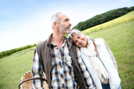Senior couple walking in countryside photo