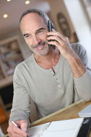 Mature man working from home Stock Photo - 22395680