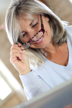websurfing: Senior woman with eyeglasses websurfing on internet