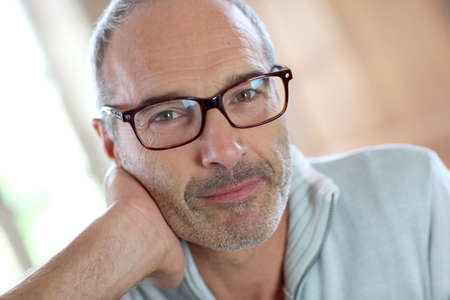 50-year-old attractive man with eyeglasses Stock Photo