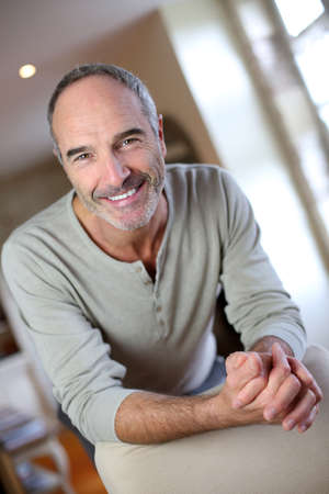 unshaved: Portrait of handsome mature man at home