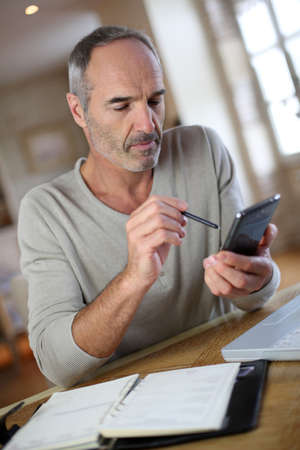 Mature man working from home Stock Photo - 22417731