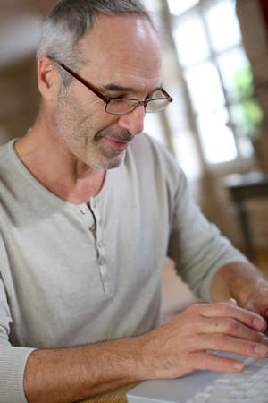 Mature man working from home Stock Photo - 22417769