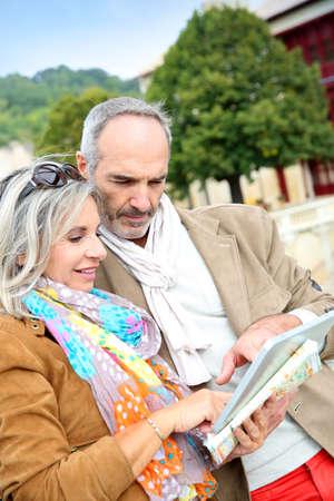 aquitaine: Senior couple of tourists on a trip