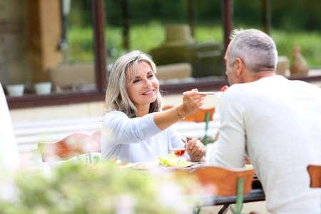 happy mature couple: Senior people having lunch in garden