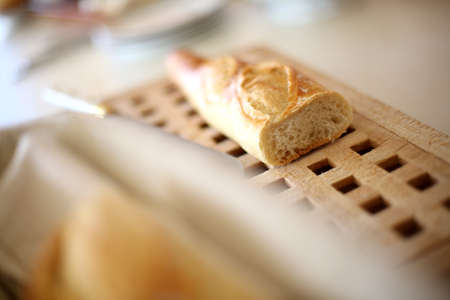 french bread: French bread set on wooden board