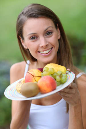 Portrait of beautiful girl holding fresh fruits Stock Photo - 22439263