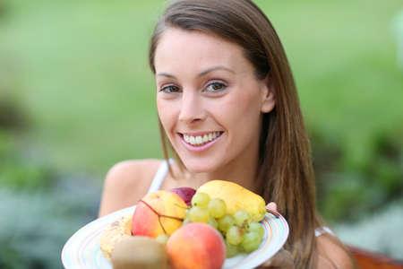 Portrait of beautiful girl holding fresh fruits Stock Photo - 22439264