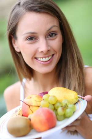 Portrait of beautiful girl holding fresh fruits Stock Photo - 22439321