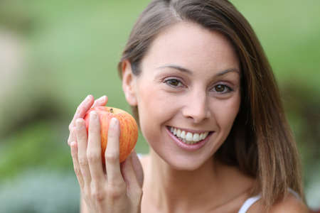Beautiful girl eating red apple Stock Photo - 22439333
