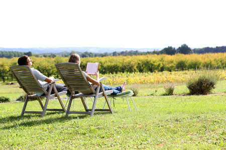 long weekend: Couple relaxing in front of beautiful landscape Stock Photo