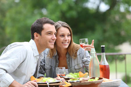 couples outdoors: Cheerful couple having lunch in hotel garden Stock Photo
