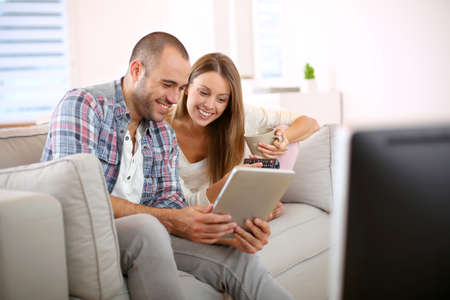 love couple: Young couple at home looking for tv progam
