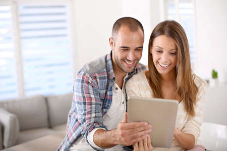 attractive couple: Young couple at home websurfing on internet