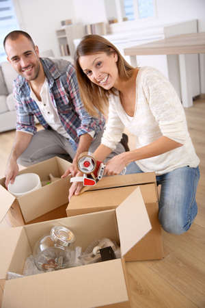 Young adults moving in new home Stock Photo - 23148398