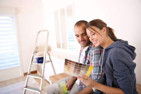 home improvements: Couple in new house choosing color for walls