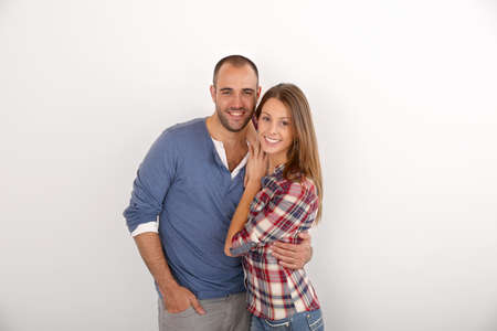 young couple: Young couple standing on white background Stock Photo