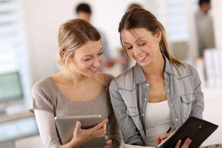 internship: Student girls doing internship in company Stock Photo