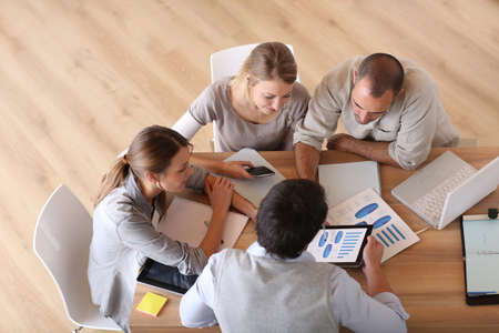 group plan: Upper view of business people around table Stock Photo