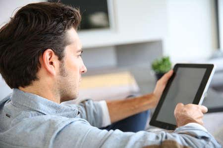 eye pad: Attractive man at home using digital tablet