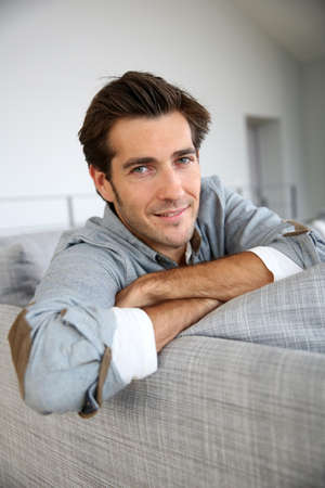 single person: Single man relaxing in sofa at home