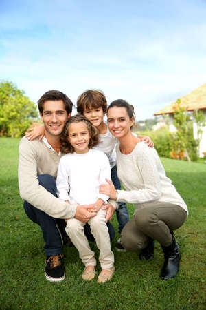 person outside: Cute family portrait of 4 people Stock Photo