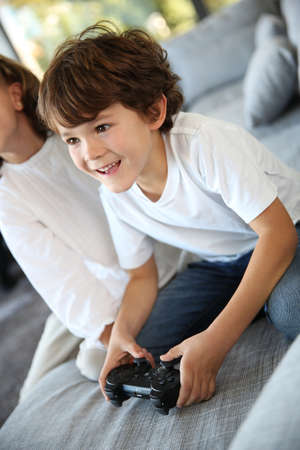 6 years: Kids at home playing video game