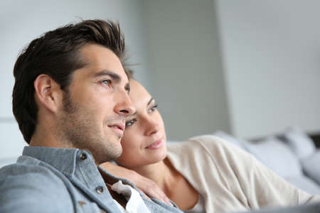 Couple at home relaxing in sofa photo